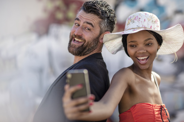happy man and woman taking a