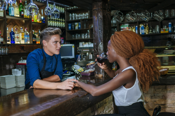 waiter flirting with woman at a