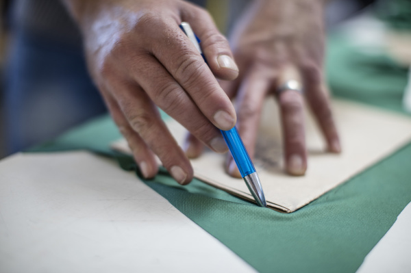 close up of tailor at work