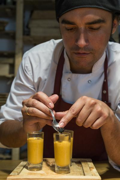 chef putting caviar in a glass