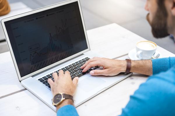 close up of businessman analyzing data