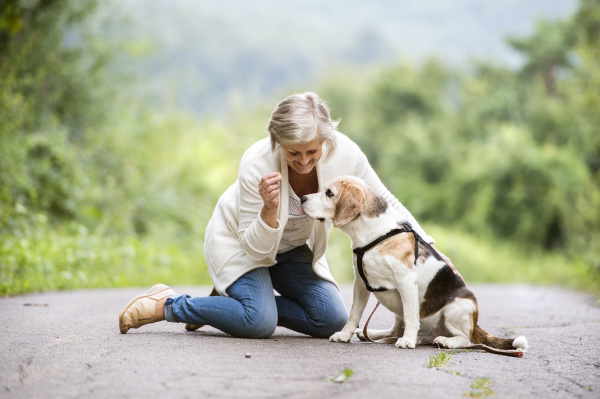 senior woman with her dog in