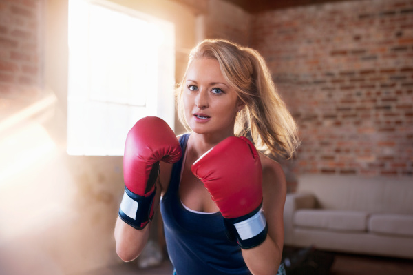 portrait tough young woman boxing in