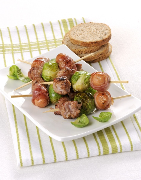 sausages wrapped in bacon and brussels