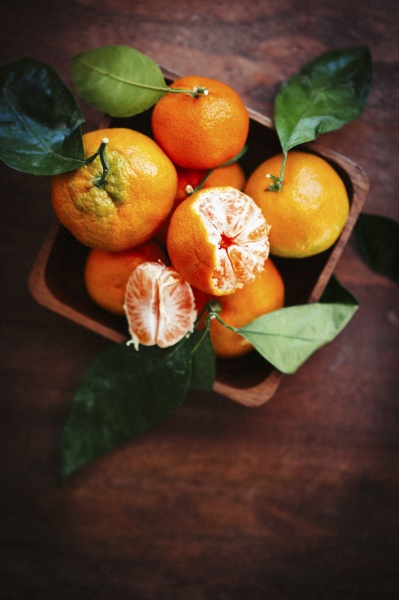 mandarins with leaves on a rustic