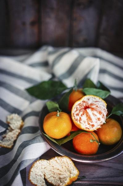 mandarins with leaves in a metal