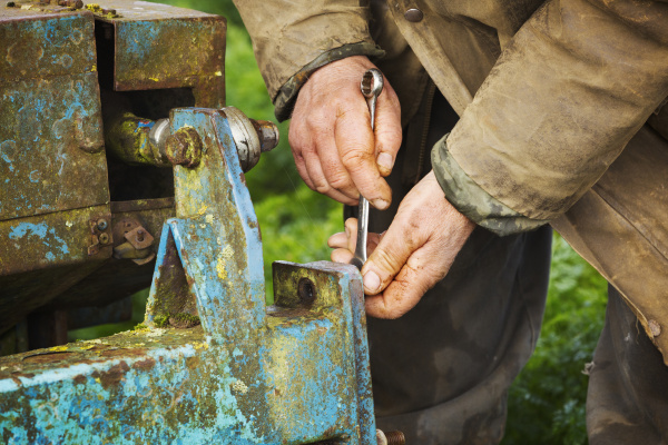 a man using a spanner on