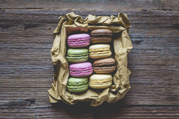 different macarons in a box on