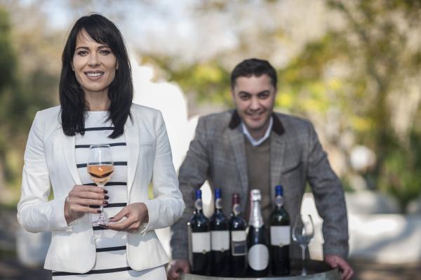 wine sales people presenting wine at