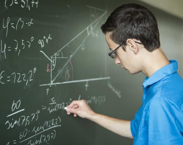 austria student calculating at blackboard