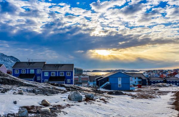 polar sunset over inuit houses on