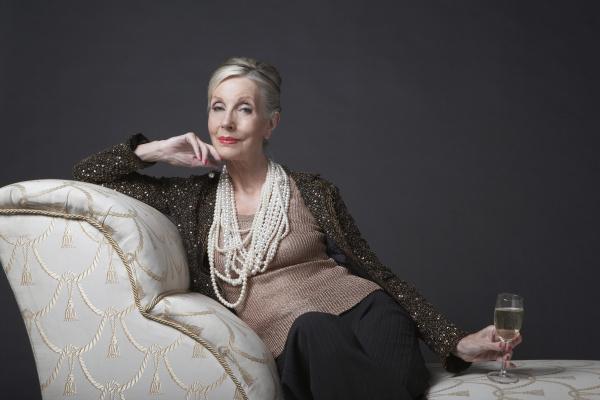 elegant senior woman on chaise lounge