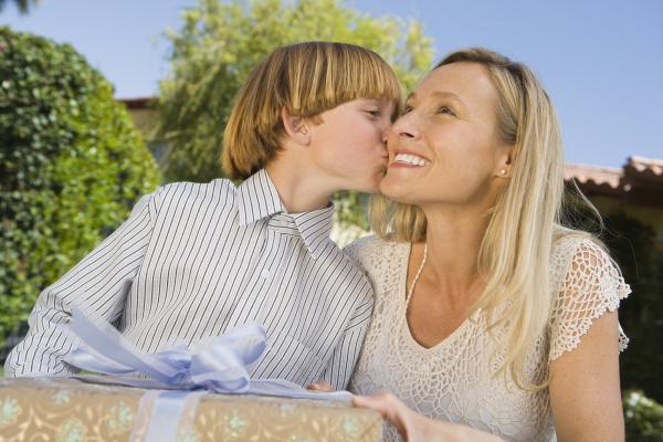 boy kissing on mother s cheek
