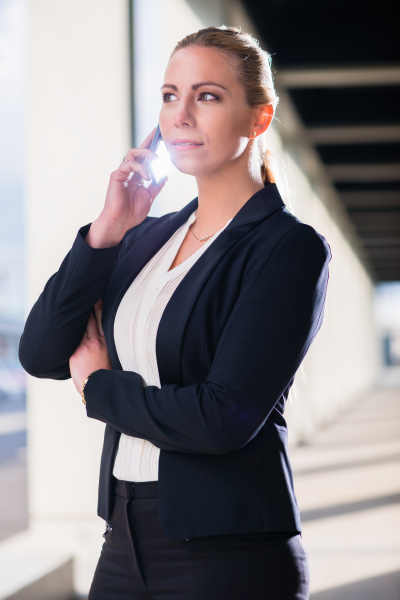 business woman with phone outdoors