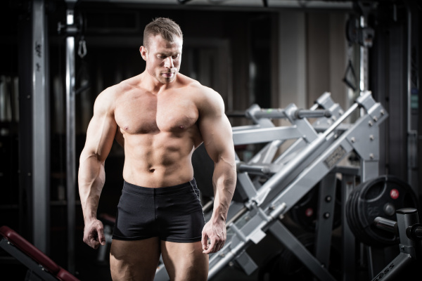 strong man doing bodybuilding in gym
