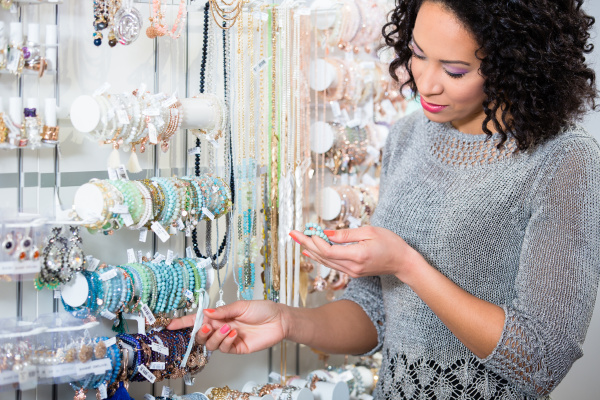 young woman looking at trinket in