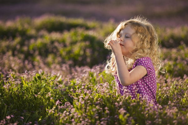 caucasian girl smelling flowers