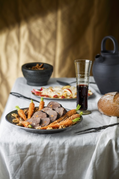 beef roast with carrots in a
