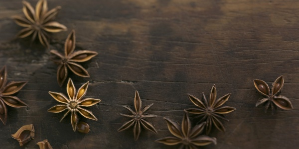 anise stars on a wooden surface