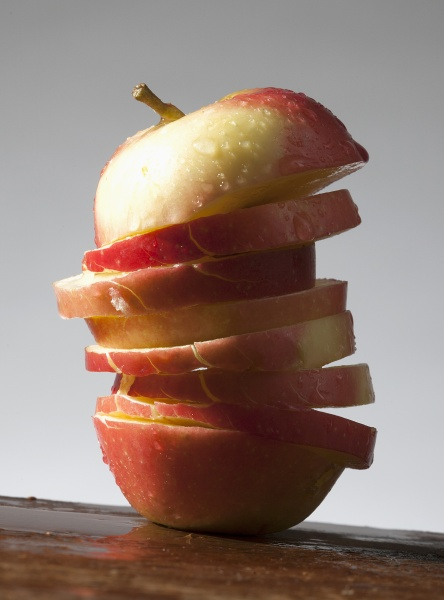an apple cut into slices with