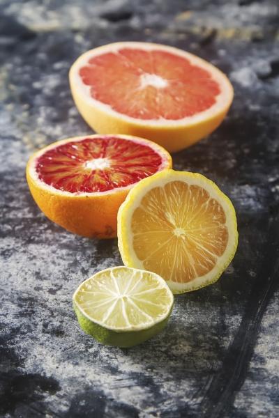 assorted citrus fruit halved