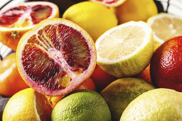 various citrus fruit in a wire