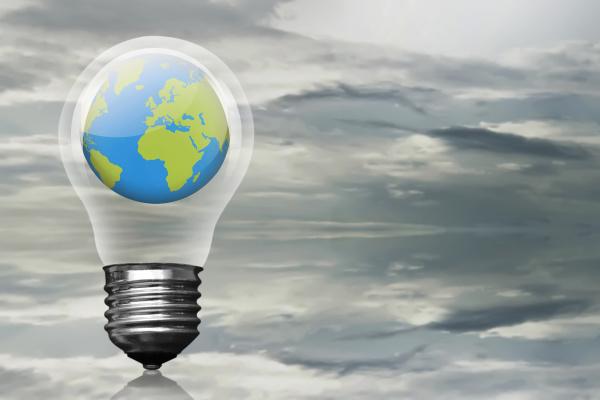 earth planet inside light bulb over