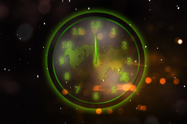 glowing green clock with world map