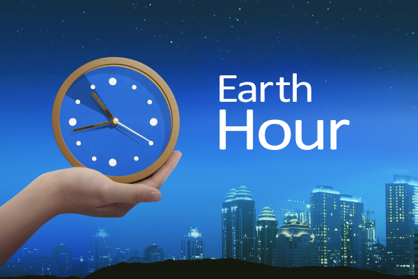 people hand holding clock with earth