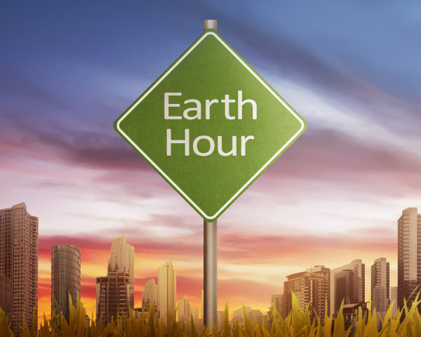 earth hour greeting on traffic sign