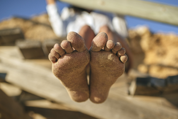 sandy feet of woman on the