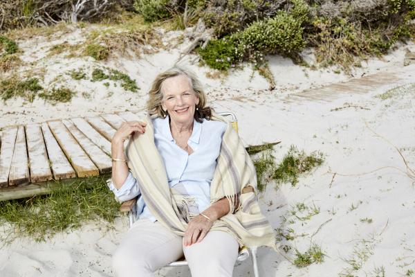 senior woman sitting on the beach