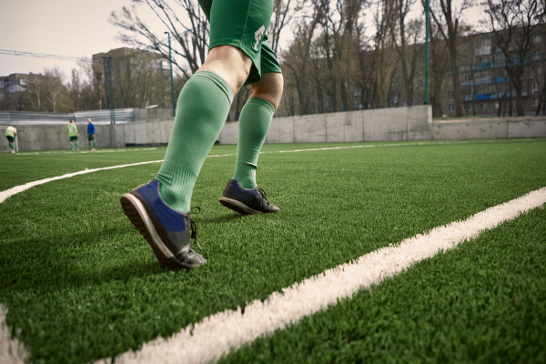the legs of soccer football player