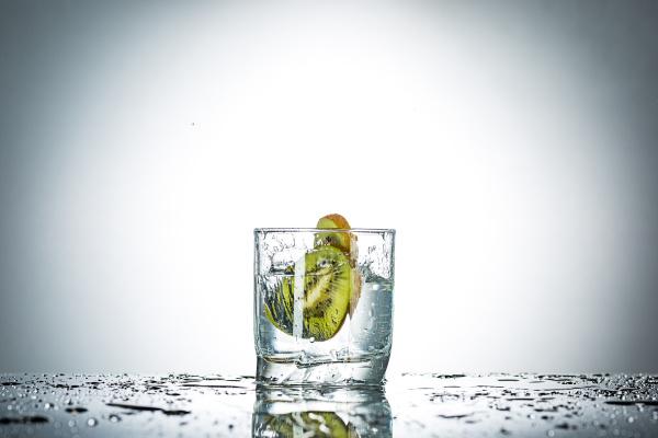 water splash in glass of gray
