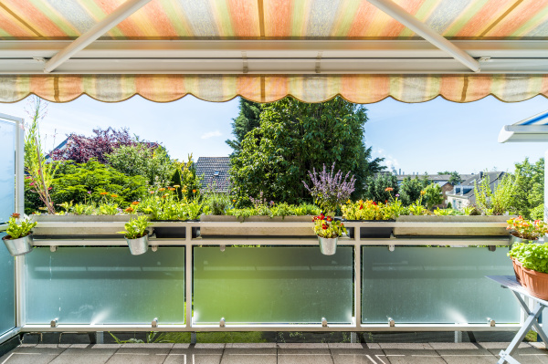 flowers on balcony with awning