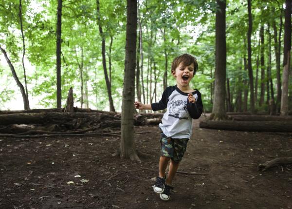 a boy child running through a