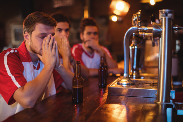 group of male friends watching football