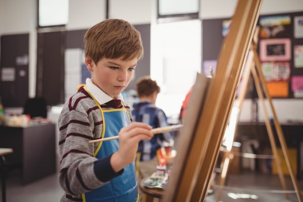 attentive schoolboy panting on canvas