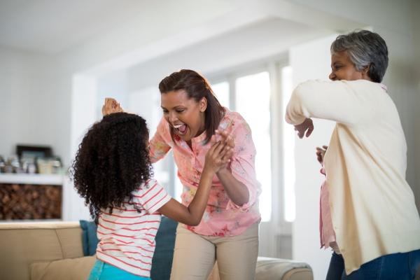 happy family having fun in living