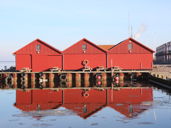 red fishermen buildings in winter with