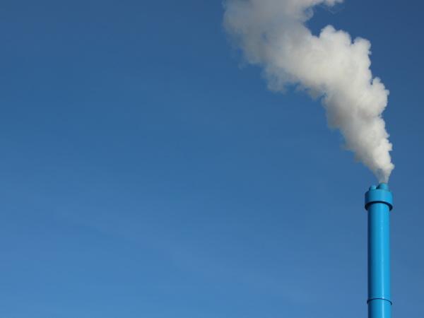 blue industrial chimney on sky background