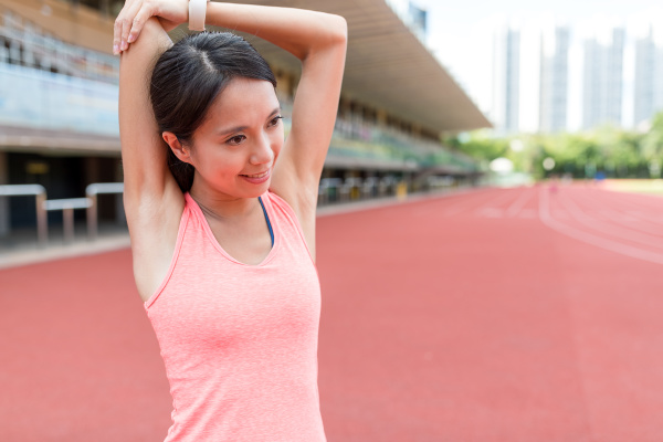 sport woman stretching arm in sport