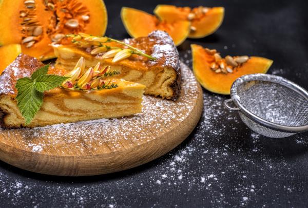 pumpkin pie on a round wooden