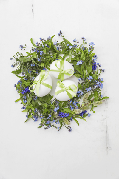 white eggs with green bows in