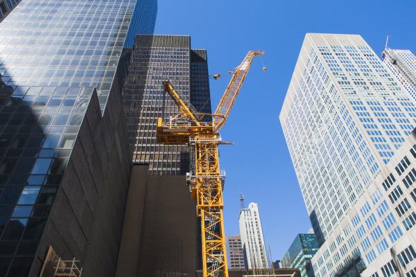 low angle view of crane among
