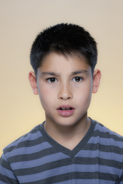 portrait of boy with concerned expression