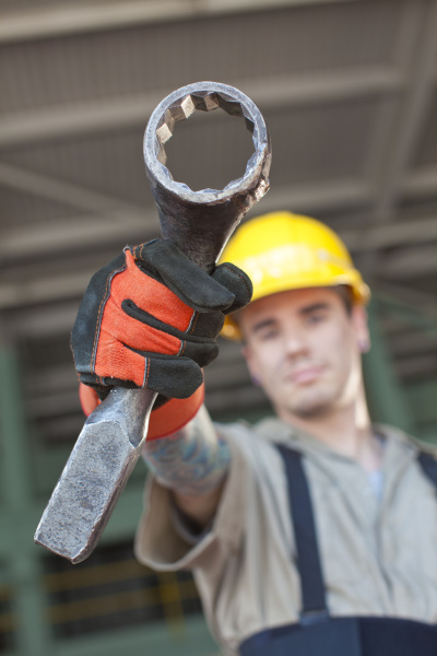portrait of male manual worker holding