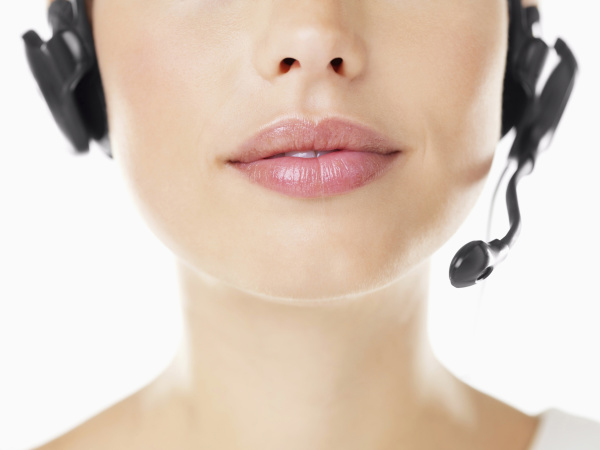 close up of woman wearing headset