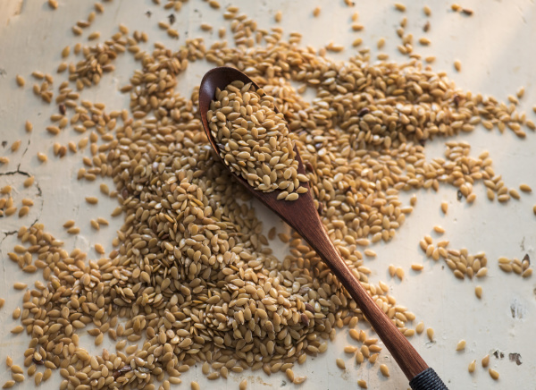 flax seeds and wooden spoon on