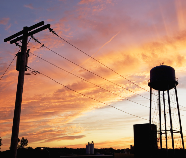 water tower and telephone pole against